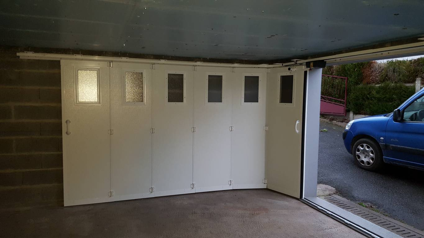 Installation d 39 une porte de garage coulissante lat rale for Porte de garage installation